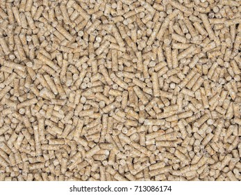 Poultry feed pellets as background.