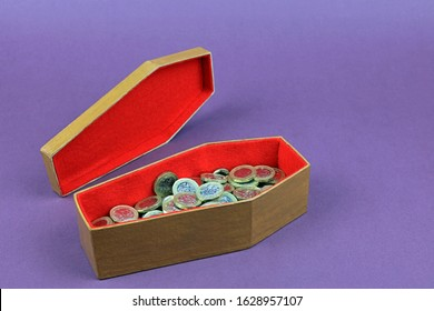 Pound Coins Inside A Coffin. The Costs Of Dying Concept.