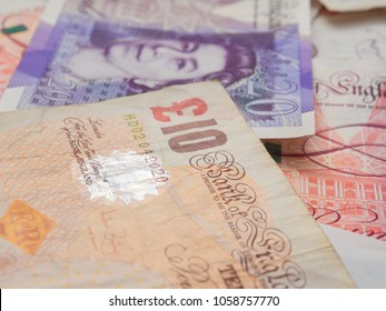 Pound money of United kingdom close up on white, Pound UK note