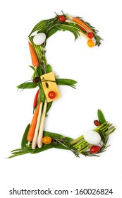 The pound sign made of vegetables with cheese in a middle.
