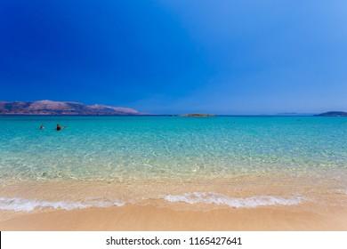 POUNDA, LAKONIA - JULY 2018: Pounda exotic beach with Elafonisos island in distance in Lakonia, Peloponnese, Greece