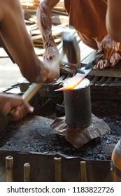 Pounding red hot iron, to make a knife,  Inle Lake,  Myanmar (Burma)