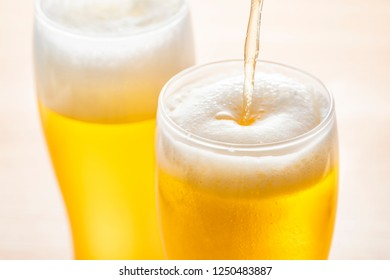 Pour beer into a glass
