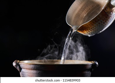 Pour boiling water into the pot