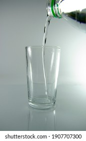 Pour carbonated water into a glassPour carbonated water into a glass