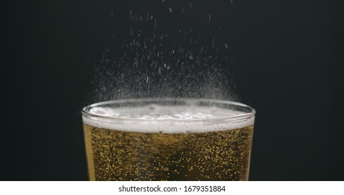 pour cider into glass with zoom out on black background
