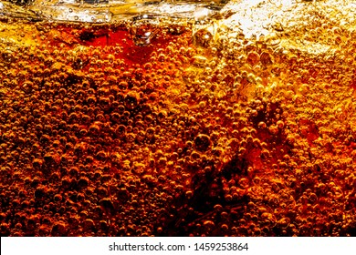Pour cola from the bottle to glass and bubble soda on black background,Detail of Cold Bubbly Carbonated Soft Drink with Ice ,Background of cola