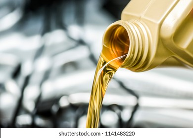 Pour motor oil to car engine. Fresh yellow liquid change with back light. Maintenance or service vehicle concept.