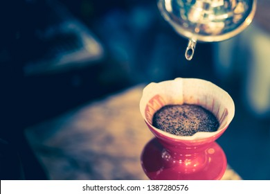 pour over coffee through red dripper, home brewing process, dark tone with copy space for poster design