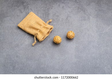 pour rattan ball from sack on concrete surface table background