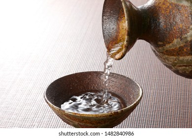 Pour from the sake bottle into a small sake cup and enjoy Japanese culture
