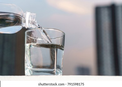 Pour water into the glass in the outdoors at home