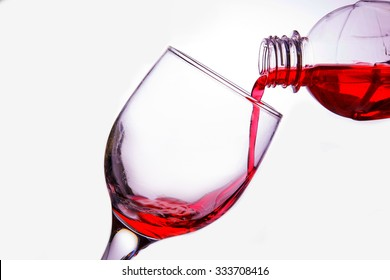 Pour the water red into the glass