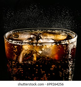 poured beverrage into a glass with ice,Cola drink is fizzy