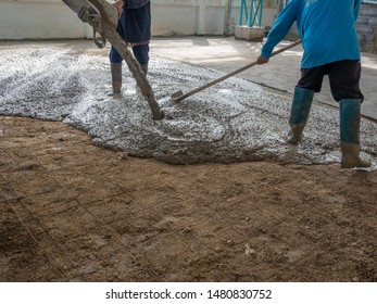 Poured mortar and workers are spreading around