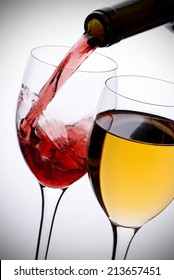 poured red wine on white background
