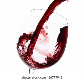 Pouring Australian red wine to wine glass isolated on white background