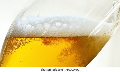 Pouring Beer into the Glass of Beer. Bottom View.