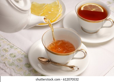 Pouring black tea / black tea with lemon