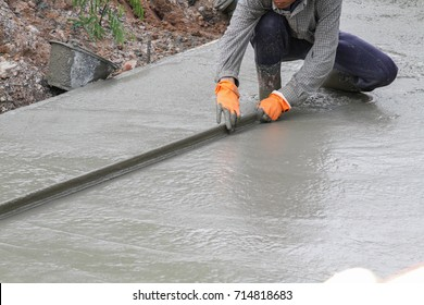 Pouring cement in the alley made by thai labor.
