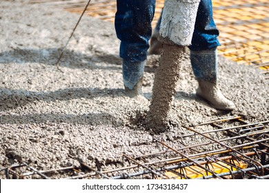 pouring cement or concrete into slabs layers of new house. Construction site details