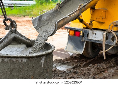 Pouring cement down from the cement mixer truck in construction site