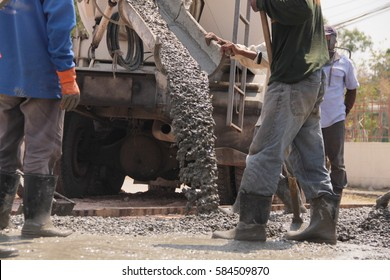 Pouring cement during for construction from concrete mixer truck car.selective focus.