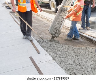 Pouring cement during sidewalk upgrade