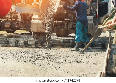 pouring cement during upgrade street at construction site
