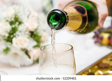 pouring champagne to the glasses