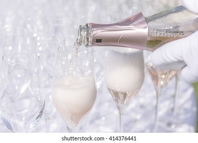 Pouring champagne into glasses, please see Shutterstock ID: 437486134 for a variation of this image