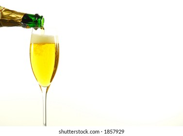 Pouring Champagne on White Background with room for Text