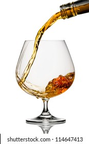 pouring cognac on white background