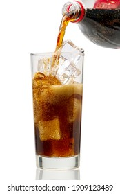 Pouring Cola to glass with ice cubes isolated on white