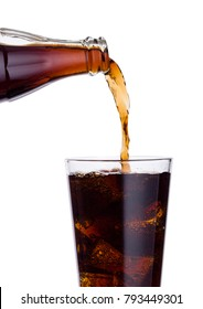 Pouring cola soda drink from bottle to glass  with ice cubes on white background