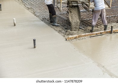 Pouring concrete into the construction of the house