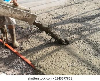 pouring concrete, ready mixed concrete at construction site