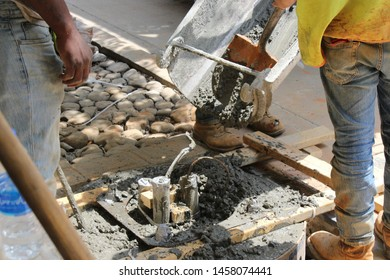Pouring concrete in a vessel on the roadside.Construction activity happening