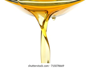 Pouring cooking oil on white background, closeup