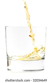 Pouring a drink into a glass with white background. Clipping path.