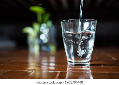 Pouring drinking water into a glass