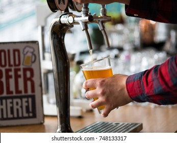 Pouring a glass of cold beer - Shutterstock ID 748133317
