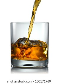 Pouring Glass of scotch whiskey and ice on a white background