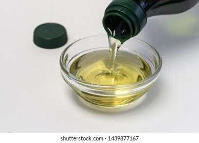 Pouring Grapeseed oil in an Ingredient Bowl
