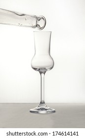 Pouring the Grappa into a glass