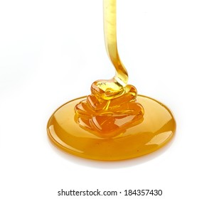 pouring honey isolated on a white background