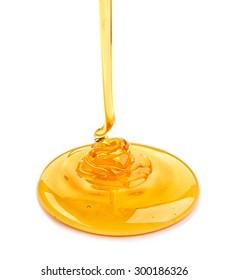 pouring honey isolated on white background