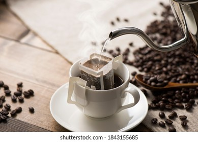 pouring hot water to coffee drip bag