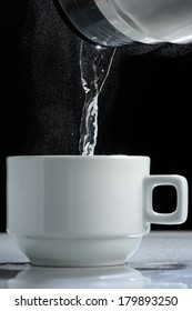 Pouring hot water into a cup
