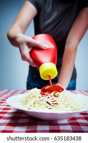 pouring a lot of ketchup sauce on spaghetti pasta